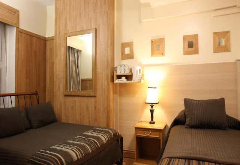 OYO Huttons Hotel